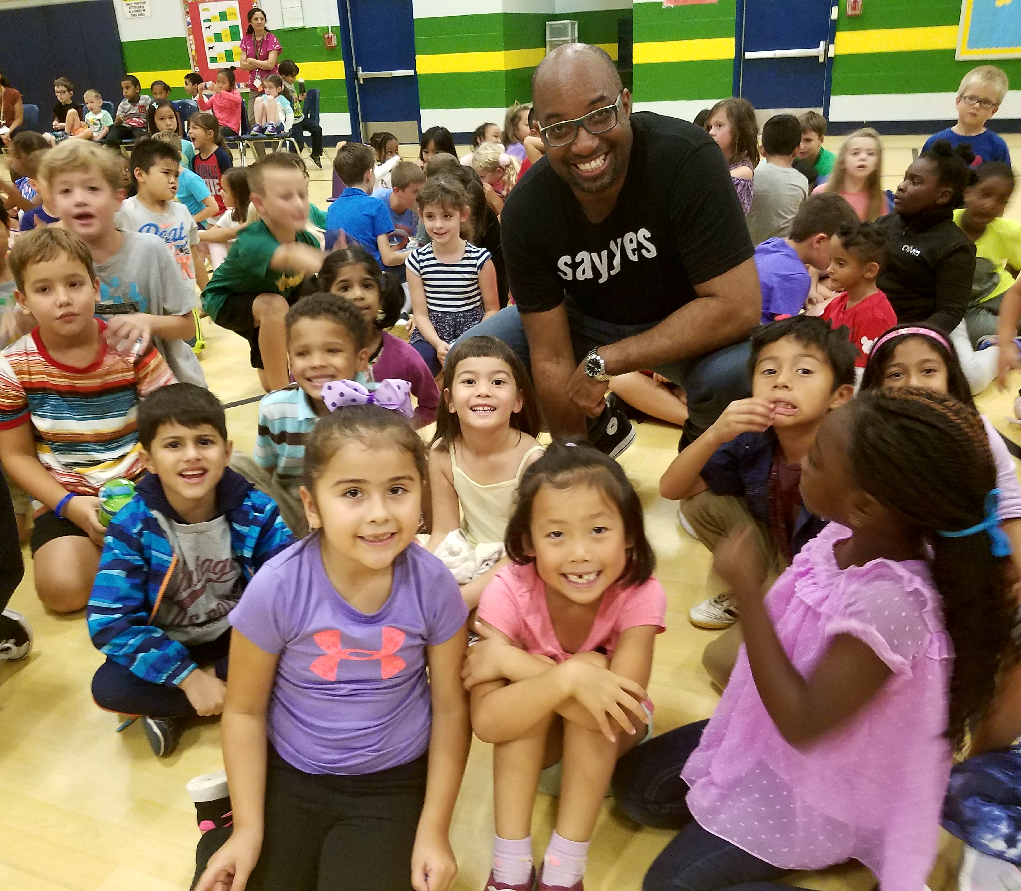 Students around Kwame Alexander, author