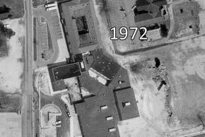 Black and white aerial photograph of Franconia Elementary School taken in 1972. The building has seen many, many additions since 1937. Much of the layout is the same as it exists today. The oldest part of the building, originally U-shaped has been enclosed as a rectangle with an open courtyard in the middle.