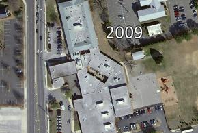Color aerial photograph of Franconia Elementary School taken in 2009. The building looks very similar to the 1972 photograph, but the school grounds and area roads have changed dramatically with the development of the area. The open courtyard in the old building has been enclosed and turned into classrooms.
